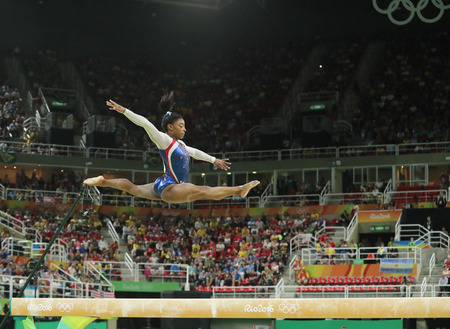 simone: RIO DE JANEIRO, BRAZIL - AUGUST 11, 2016: Olympic champion Simone Biles of United States competing on the balance beam at womens all-around gymnastics at Rio 2016 Olympic Games