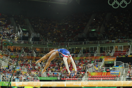RIO DE JANEIRO, BRAZIL - AUGUST 11, 2016: Olympic champion Simone Biles of United States competing on the balance beam at womens all-around gymnastics at Rio 2016 Olympic Games