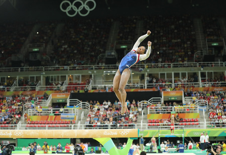 olympic ring: RIO DE JANEIRO, BRAZIL - AUGUST 11, 2016: Olympic champion Simone Biles of United States competing on the balance beam at womens all-around gymnastics at Rio 2016 Olympic Games