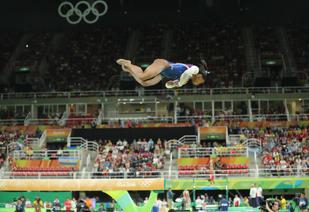 olympic symbol: RIO DE JANEIRO, BRAZIL - AUGUST 11, 2016: Olympic champion Simone Biles of United States competing on the balance beam at womens all-around gymnastics at Rio 2016 Olympic Games