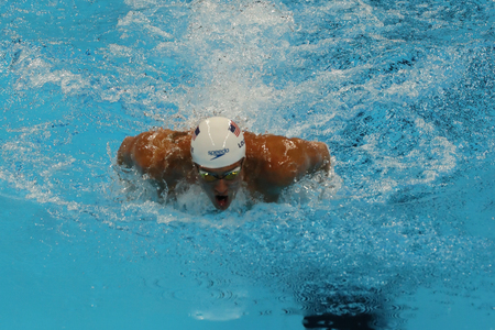 piscina olimpica: RIO DE JANEIRO, BRAZIL - AUGUST 10, 2016: Olympic champion Ryan Lochte of United States competes at the Mens 200m individual medley relay of the Rio 2016 Olympic Games at the Olympic Aquatics Stadium