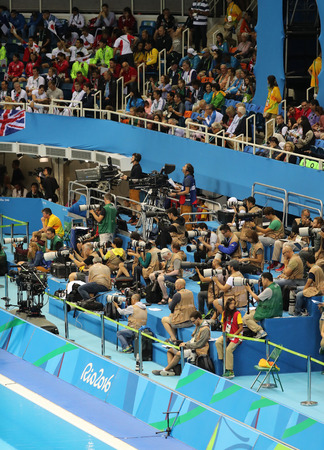 piscina olimpica: RIO DE JANEIRO, BRAZIL - AUGUST 10, 2016: Professional sport photographers during the Rio 2016 Olympic Games at the Olympic Aquatics Stadium