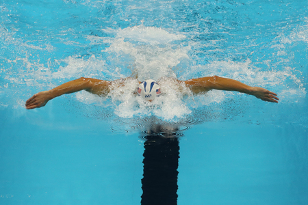 piscina olimpica: RIO DE JANEIRO, BRAZIL - AUGUST 10, 2016:Olympic champion Michael Phelps of United States competes at the Mens 200m individual medley of the Rio 2016 Olympic Games at the Olympic Aquatics Stadium