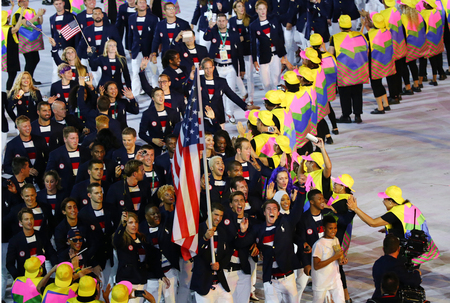 olympic ring: RIO DE JANEIRO, BRAZIL - AUGUST 5, 2016: Olympic champion Michael Phelps carrying the United States flag leading the Olympic team USA in the Rio 2016 Opening Ceremony at Maracana Stadium