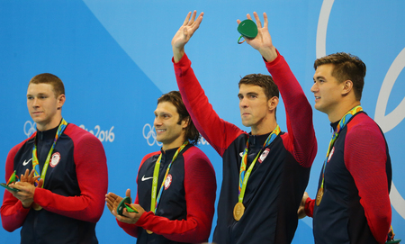 medley: RIO DE JANEIRO, BRAZIL - AUGUST 13, 2016: USA Mens 4x100m medley relay team Ryan Murphy (L), Cory Miller,  Michael Phelps and Nathan Adrian celebrate victory at the Rio 2016 Olympic Games Editorial