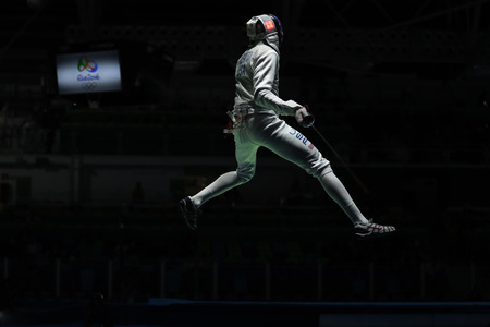 olympic ring: RIO DE JANEIRO, BRAZIL - AUGUST 12, 2016: Miles Chamley-Watson of United States competes in the Mens team foil of the Rio 2016 Olympic Games at the Carioca Arena 3 Editorial