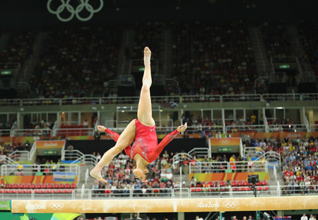 olympic ring: RIO DE JANEIRO, BRAZIL - AUGUST 11, 2016: Olympic champion Aly Raisman of United States competing on the balance beam at womens all-around gymnastics at Rio 2016 Olympic Games