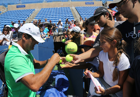 champion spain: NEW YORK - AUGUST 23, 2016: Tennis coach Tony Nadal of Spain signing autographs after practice with Grand Slam champion Rafael Nadal for US Open 2016 at Billie Jean King National Tennis Center