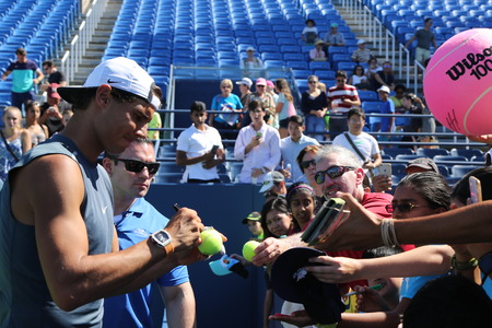 champion spain: NEW YORK - AUGUST 23, 2016: Grand Slam champion Rafael Nadal of Spain signing autographs after practice for US Open 2016 at Billie Jean King National Tennis Center