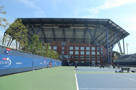 new and improved: NEW YORK - AUGUST 25, 2016: Practice courts and newly Improved Arthur Ashe Stadium at the Billie Jean King National Tennis Center ready for US Open tournament in Flushing, NY
