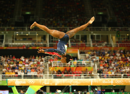 simone: RIO DE JANEIRO, BRAZIL AUGUST 7, 2016: Olympic champion Simone Biles of United States competing on the balance beam at womens all-around gymnastics qualification at Rio 2016 Olympic Games