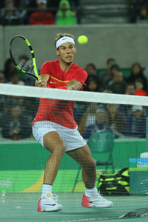 RIO DE JANEIRO, BRAZIL - AUGUST 12, 2016: Olympic champion Rafael Nadal of Spain in action during mens doubles final of the Rio 2016 Olympic Games at the Olympic Tennis Centre Editorial
