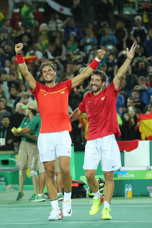 doubles: RIO DE JANEIRO, BRAZIL - AUGUST 12, 2016: Olympic champions Rafael Nadal (L) and Mark Lopez of Spain celebrate victory at mens doubles final of the Rio 2016 Olympic Games at the Olympic Tennis Centre