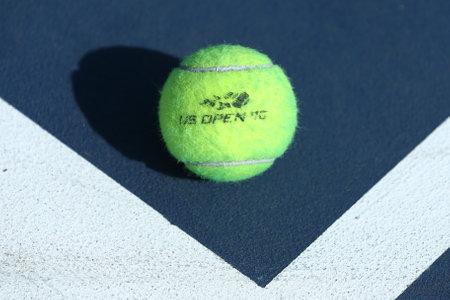 wilson: NEW YORK - AUGUST 27, 2016: US Open Wilson tennis ball at Billie Jean King National Tennis Center in New York. Wilson is the Official Ball of the US Open since 1979 Editorial