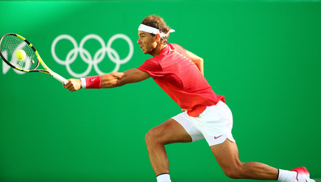 RIO DE JANEIRO, BRAZIL - AUGUST 12, 2016: Olympic champion Rafael Nadal of Spain in action during mens singles quarterfinal of the Rio 2016 Olympic Games at the Olympic Tennis Centre
