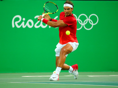 champion spain: RIO DE JANEIRO, BRAZIL - AUGUST 12, 2016: Olympic champion Rafael Nadal of Spain in action during mens singles quarterfinal of the Rio 2016 Olympic Games at the Olympic Tennis Centre