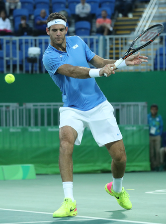 olympic ring: RIO DE JANEIRO, BRAZIL - AUGUST 12, 2016: Grand Slam Champion Juan Martin Del Porto of Argentina in action during mens singles quarterfinal of the Rio 2016 Olympic Games at the Olympic Tennis Centre Editorial