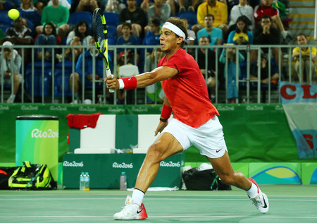 RIO DE JANEIRO, BRAZIL - AUGUST 8, 2016: Olympic champion Rafael Nadal of Spain in action during mens doubles round 2 of the Rio 2016 Olympic Games at the Olympic Tennis Centre