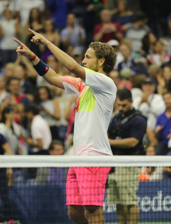 racket stadium: NEW YORK - SEPTEMBER 4, 2016: Professional tennis player Lukas Poulle of France celebrates victory over Rafael Nadal after round three match at US Open 2016 at Billie Jean King National Tennis Center