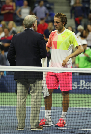 center court: NEW YORK - SEPTEMBER 4, 2016: Professional tennis player Lukas Poulle of France during on court interview after round three match win at US Open 2016 at Billie Jean King National Tennis Center