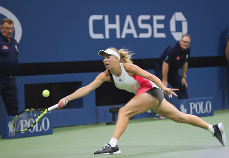 NEW YORK - SEPTEMBER 5, 2016: Professional tennis player Caroline Wozniacki of Denmark in action during her round four match at US Open 2016 at Billie Jean King National Tennis Center in NewYork Editorial
