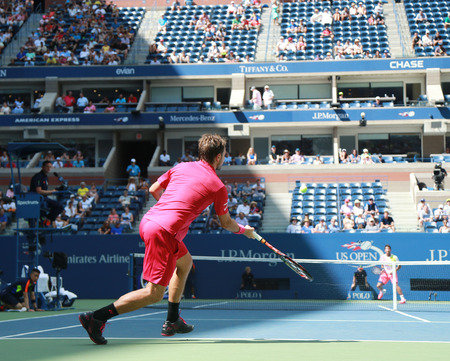 billie: NEW YORK - AUGUST 30, 2016: Grand Slam champion Stanislas Wawrinka of Switzerland in action during his first round match at US Open 2016 at Billie Jean King National Tennis Center in NY
