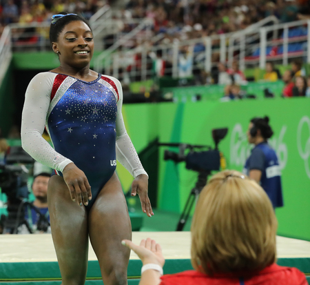 olympic ring: RIO DE JANEIRO, BRAZIL - AUGUST 11, 2016: Olympic champion Simone Biles of United States after competing on the balance beam at womens all-around gymnastics at Rio 2016 Olympic Games Editorial
