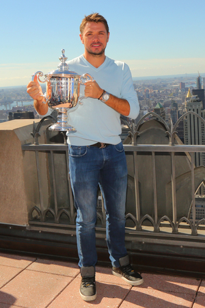 NEW YORK - SEPTEMBER 12, 2016: Three times Grand Slam champion Stanislas Wawrinka of Switzerland poses with US Open trophy on the Top of the Rock Observation Deck at Rockefeller Center in New York