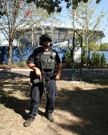 counter terrorism: NEW YORK - AUGUST 30, 2016: NYPD counter terrorism officer providing security at National Tennis Center during US Open 2016 in New York