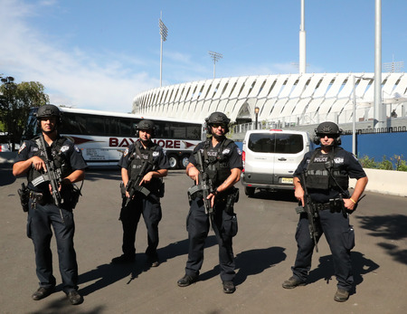 best security: NEW YORK - AUGUST 30, 2016: NYPD counter terrorism officers providing security at National Tennis Center during US Open 2016 in New York Editorial