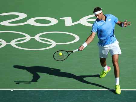 RIO DE JANEIRO, BRAZIL - AUGUST 13, 2016: Grand Slam Champion Juan Martin Del Porto of Argentina in action during mens singles semifinal of the Rio 2016 Olympic Games at the Olympic Tennis Centre