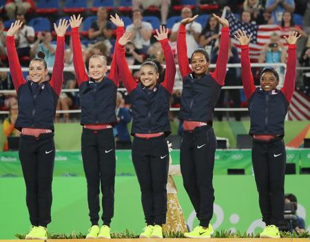 olympic symbol: RIO DE JANEIRO, BRAZIL - AUGUST 9, 2016: Team USA womens team all-around gymnastics winners at Rio 2016 Olympic Games Raisman (L), Kocian, Hernandez, Douglas and Simone Biles during medal ceremony