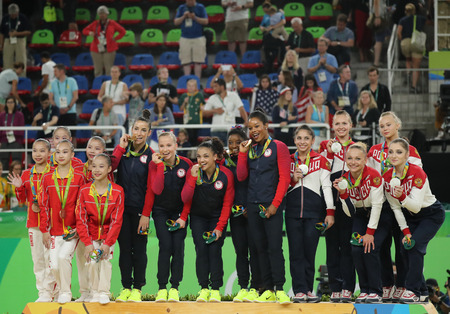 RIO DE JANEIRO, BRAZIL - AUGUST 9, 2016: Womens team all-around gymnastics winners at Rio 2016 Olympic Games team China (L), team USA and team Russia during medal ceremony at Rio Olympic Arena
