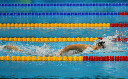 piscina olimpica: RIO DE JANEIRO, BRAZIL - AUGUST 12, 2016: Olympic champion Katie Ledecky of United States competes at the Womens 800m freestyle of the Rio 2016 Olympic Games at the Olympic Aquatics Stadium