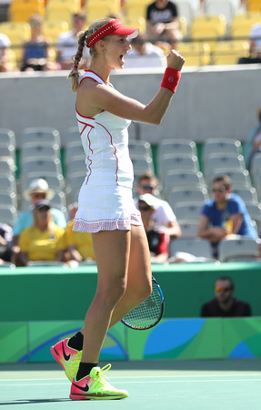 RIO DE JANEIRO, BRAZIL - AUGUST 14, 2016: Ekaterina Makarova of Russia in action during womens doubles final of the Rio 2016 Olympic Games at the Olympic Tennis Centre