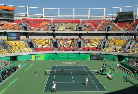 olympic game: RIO DE JANEIRO, BRAZIL - AUGUST 14, 2016: Main tennis venue Maria Esther Bueno Court of the Rio 2016 Olympic Games during womens doubles final game at the Olympic Tennis Centre