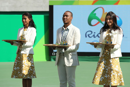 RIO DE JANEIRO, BRAZIL - AUGUST 14, 2016: Tennis womens doubles final medal ceremony at the Maria Esther Bueno Court of the Rio 2016 Olympic Games at the Olympic Tennis Centre