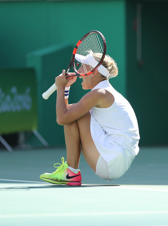 doubles: RIO DE JANEIRO, BRAZIL - AUGUST 14, 2016: Elena Vesnina of Russia celebrates victory after womens doubles final of the Rio 2016 Olympic Games at the Olympic Tennis Centre Editorial