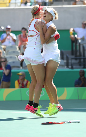 doubles: RIO DE JANEIRO, BRAZIL - AUGUST 14, 2016: Ekaterina Makarova (L) and Elena Vesnina of Russia celebrate victory after womens doubles final of the Rio 2016 Olympic Games at the Olympic Tennis Centre Editorial