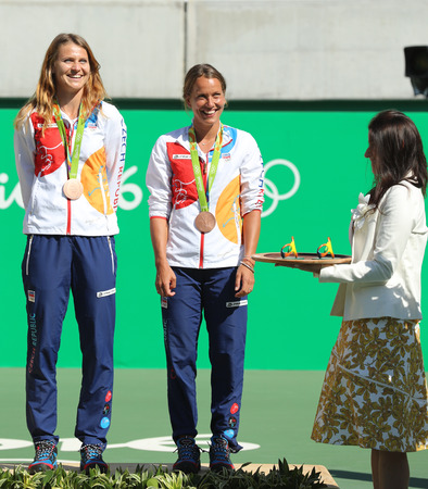 RIO DE JANEIRO, BRAZIL - AUGUST 14, 2016: Bronze medalists team Czech Lucie Safarova (L) and Barbora Strycova during medal ceremony after tennis womens doubles final of the Rio 2016 Olympic Games Editorial
