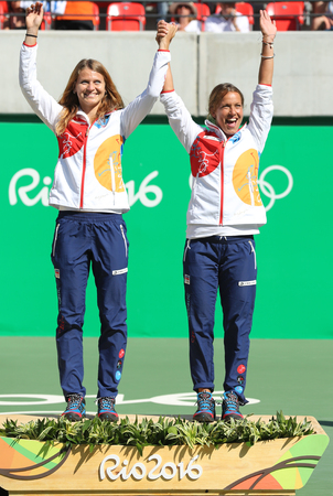 olympic symbol: RIO DE JANEIRO, BRAZIL - AUGUST 14, 2016: Bronze medalists team Czech Lucie Safarova (L) and Barbora Strycova during medal ceremony after tennis womens doubles final of the Rio 2016 Olympic Games Editorial