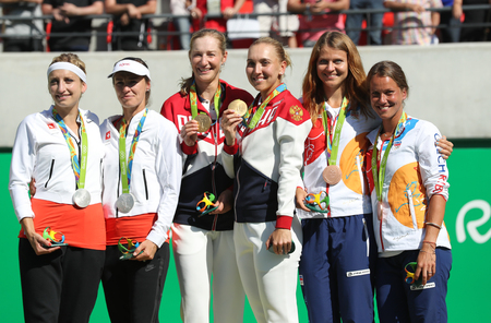 doubles: RIO DE JANEIRO, BRAZIL - AUGUST 14, 2016:Tennis womens doubles medalists team Switzerland (L), team Russia and team Czech during medal ceremony of the Rio 2016 Olympic Games at Olympics Tennis Centre Editorial