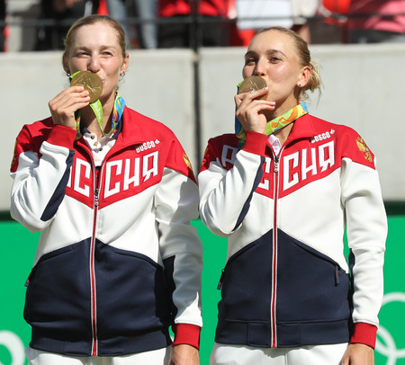 doubles: RIO DE JANEIRO, BRAZIL - AUGUST 14, 2016: Olympic champions team Russia Ekaterina Makarova (L) and Elena Vesnina during medal ceremony after tennis womens doubles final of the Rio 2016 Olympic Games Editorial