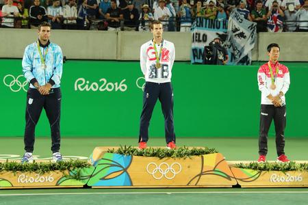RIO DE JANEIRO, BRAZIL - AUGUST 14, 2016:Juan Martin Del Porto ARG (L), Olympic champion Andy Murray GBR and Kei Nishikori JPN during tennis mens singles medal ceremony of the Rio 2016 Olympic Games Editorial