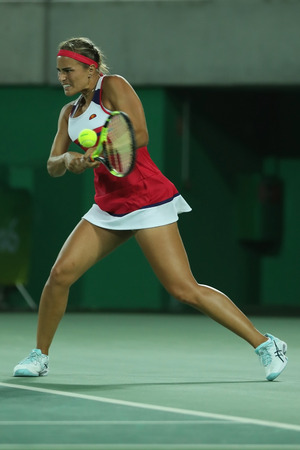 RIO DE JANEIRO, BRAZIL - AUGUST 13, 2016: Olympic champion Monica Puig of Puerto Rico in action during tennis womens singles final of the Rio 2016 Olympic Games at the Olympic Tennis Centre