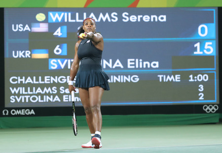 olympic ring: RIO DE JANEIRO, BRAZIL - AUGUST 9, 2016: Olympic champions Serena Williams of United States in action during singles round three match of the Rio 2016 Olympic Games at the Olympic Tennis Centre Editorial