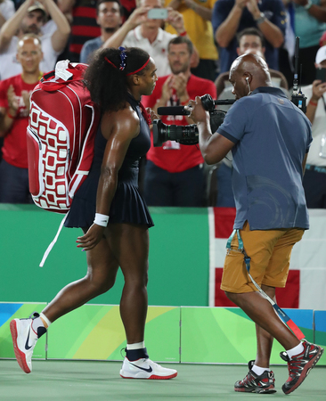 olympic ring: RIO DE JANEIRO, BRAZIL - AUGUST 9, 2016: Olympic champion Serena Williams of United States leaving court after loss to Elena Svitolina of Ukraine at round three match of the Rio 2016 Olympic Games