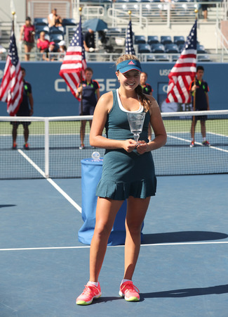 grand hard: NEW YORK - SEPTEMBER 11, 2016: US Open 2016 girls junior champion Kayla Day of United States during trophy presentation at the Billie Jean King National Tennis Center in New York