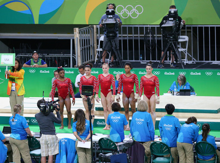 marta: RIO DE JANEIRO, BRAZIL - AUGUST 4, 2016: Team United States during an artistic gymnastics training session for Rio 2016 Olympics at the Rio Olympic Arena Editorial