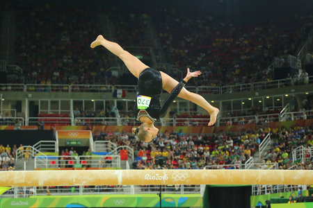 olympic symbol: RIO DE JANEIRO, BRAZIL - AUGUST 15, 2016:Olympic champion Sanne Wevers  of Netherlands competes at the final on the balance beam womens artistic gymnastics at Rio 2016 Olympic Games